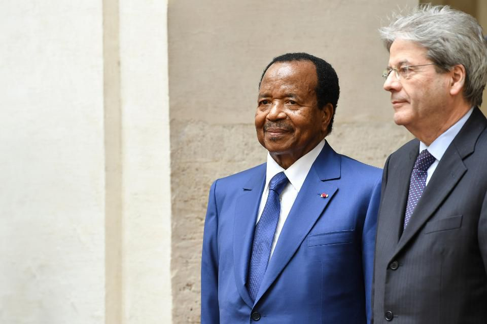 Italy's Prime Minister Paolo Gentiloni (R) greets Cameroon's President Paul Biya (C) before their meeting on March 20, 2017 at the Palazzo Chigi in Rome. / AFP PHOTO / ANDREAS SOLARO (Photo credit should read ANDREAS SOLARO/AFP/Getty Images)